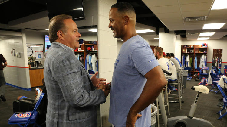 South Bend Cubs owner Andrew Berlin greets manager Jimmy Gonzalez
