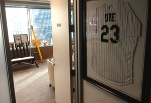 A framed White Sox Jermaine Dye jersey greets all visitors to Andrew Berlin's office.